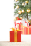 Cute red gift box with gold ribbon Royalty Free Stock Image