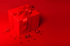 Cute red gift box on the red background Royalty Free Stock Image