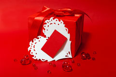 Cute red gift box with Valentines card Stock Images