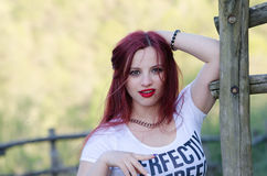 Cute red hair lady outside Stock Images