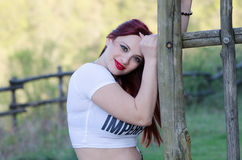 Cute red hair lady outside Stock Photography