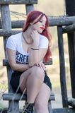 Cute red hair lady outside Stock Photo