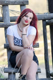 Cute red hair lady outside Stock Photos