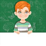 Cute red haired boy holds large white horizontal banner Stock Photo
