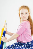 Cute Red-haired Caucasain Girl Holding Huge Pencils Royalty Free Stock Images