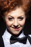 Cute red-haired girl posing coquettishly at camera Stock Image
