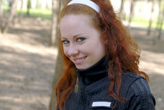Cute red-haired girl smiling. Cute red-haired girl with blue eyes smiling Stock Photos