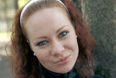 Cute red-haired girl smiling. Cute red-haired girl with blue eyes smiling Stock Photo