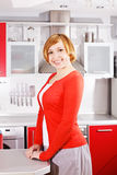 Cute red-haired housewife at home stock images