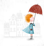 Cute red-head girl with umbrella in blue coat on city background. Stock Images