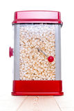 Cute red popcorn popping device Stock Photography