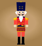Cute red retro Nutcracker. Tin soldier or Nutcracker with drum. Vector Royalty Free Stock Photography