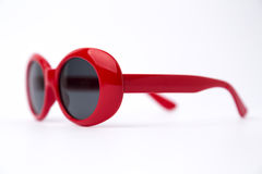 Cute red round sunglasses on white background Royalty Free Stock Photos