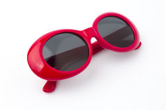 Cute red round sunglasses on white background Royalty Free Stock Photo