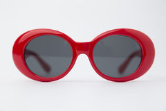 Cute red round sunglasses on white background Stock Photography