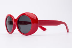 Cute red round sunglasses on white background Stock Photos