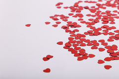 Cute red scattered sequin hearts on a white background. Perfect for weddings and valentines Royalty Free Stock Photo