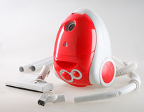 Cute red vacuum cleaner Stock Image