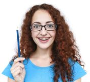 Cute redhead with a broad smile girl having good idea. royalty free stock image