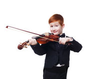 Cute redhead child boy plays violin isolated at white background Royalty Free Stock Image
