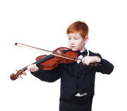 Cute redhead child boy plays violin isolated at white background Royalty Free Stock Photo