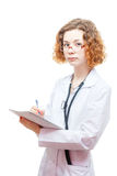 Cute redhead doctor in lab coat and glasses with nothebook Stock Image