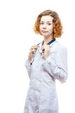 Cute redhead doctor in lab coat with stethoscope Royalty Free Stock Image