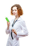 Cute redhead doctor in lab coat with syringe Stock Photo