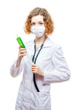 Cute redhead doctor in lab coat with syringe in mask. Isolated on white background Royalty Free Stock Photos