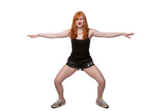 Cute redhead exercising Stock Images