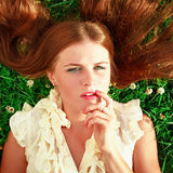 Cute redhead female lying down Stock Photos