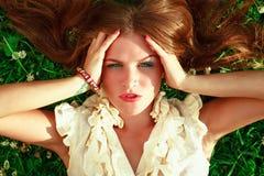 Cute redhead female lying down Royalty Free Stock Photos