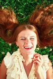 Cute redhead female lying down Royalty Free Stock Images