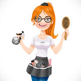 Cute redhead girl hairdresser with spray and hairbrush portrait Royalty Free Stock Photography