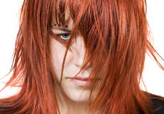 Cute redhead girl with messy hair. Cute redhead girl looking aggressively at the camera with messy or distressed hair. Studio shot royalty free stock photo