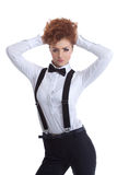 Cute redhead girl posing in suit with suspenders Stock Image