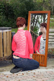 Cute Redhead Outdoors with a Mirror Stock Images