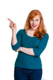 Cute redhead, pointing to space for text Royalty Free Stock Photos