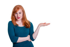 Cute redhead, pointing to space for text Stock Image