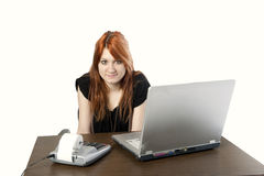 Cute redhead secretary Stock Photography