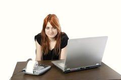 Cute redhead secretary Stock Photography