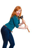 Cute redhead singing into plunger Stock Photos
