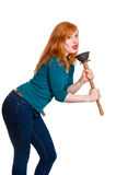 Cute redhead singing into plunger Royalty Free Stock Photo