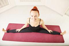 Cute redhead stretching legs out Stock Photos