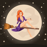 Cute redhead witch flying on a broom Stock Photo