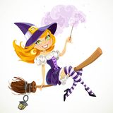 Cute redhead witch with magic wand flying on a broom Royalty Free Stock Images