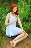 Cute redhead woman with dandelions. royalty free stock photo