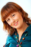 Cute Redhead woman portrait. Happy young woman smiling with friendly look Royalty Free Stock Photo