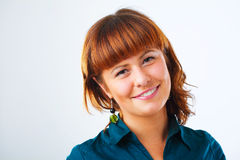 Cute Redhead woman portrait. Happy young woman smiling with friendly look Stock Photo
