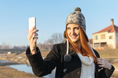 Cute redhead young woman taking a selfie Stock Photos